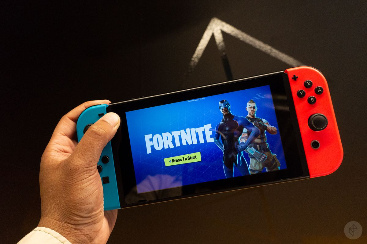 Fortnite running on a Nintendo Switch being held by a left hand