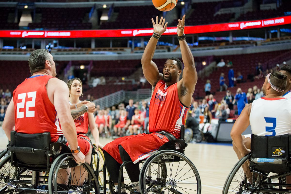 Actor LaRoyce Hawkins (center), during the Wheelchair Basketball Exhibition Game as part of the 2017 Warrior Games at United Center on Friday, July 7, 2017.