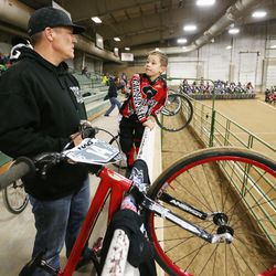 Connor Clifford, 6, talks with his dad, Lance, prior to racing BMX in South Jordan on Dec. 6, 2015.