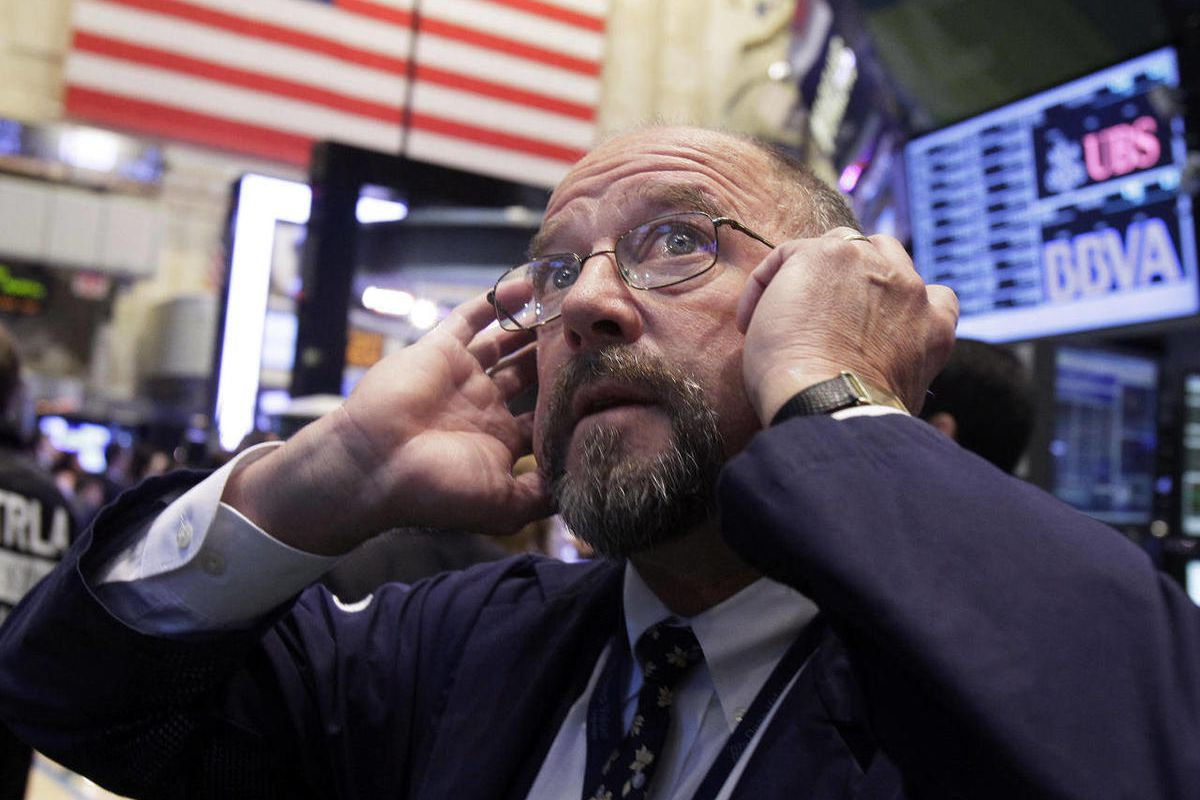 In this Sept. 20, 2012, file photo Trader Frederick Reimer works on the floor of the New York Stock Exchange. World stock markets fell Monday, Sept. 24, 2012 weighed down by a host of concerns about the global economy.