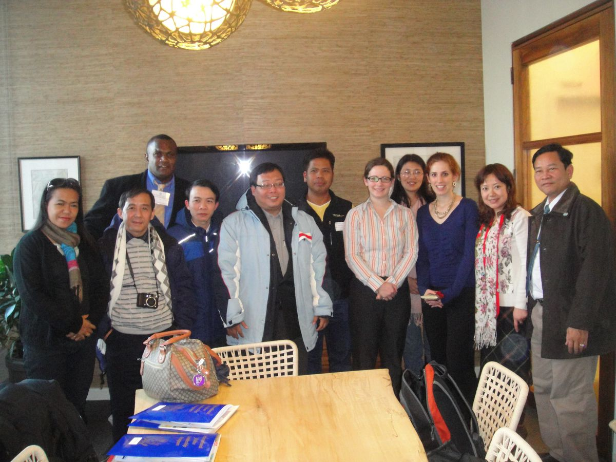 Educators from across East Asia posed with GothamSchools advisory board member Genevieve Wachtell and editor Elizabeth Green Friday.