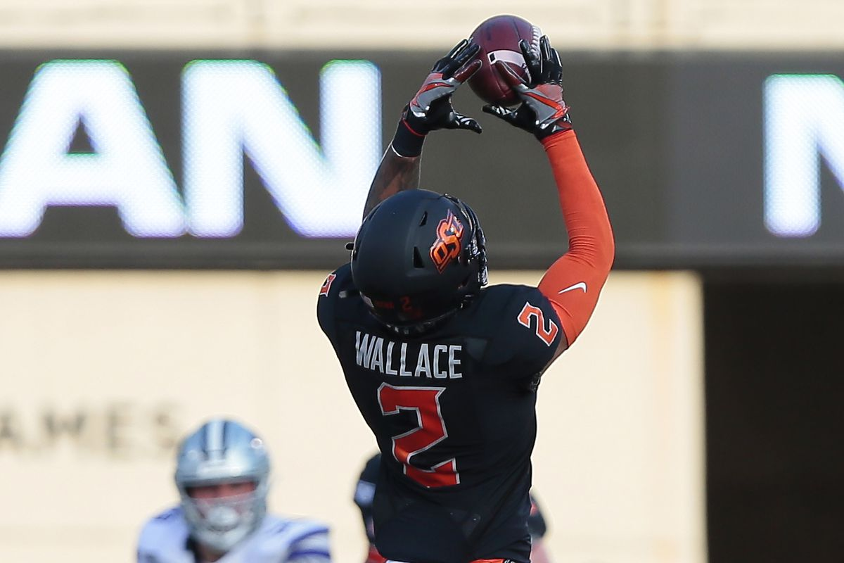 Wide receiver Tylan Wallace #2 of the Oklahoma State Cowboys leaps to catch a pass for 25 yards against the Kansas State Wildcats on the first play from scrimmage on September 28, 2019 at Boone Pickens Stadium in Stillwater, Oklahoma. OSU won 26-13.