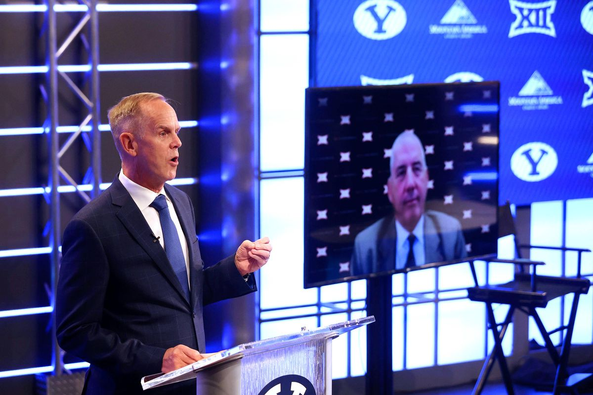 BYU athletic director Tom Holmoe speaks at a press conference where the school announced it accepted an invitation to join the Big 12 Conference.