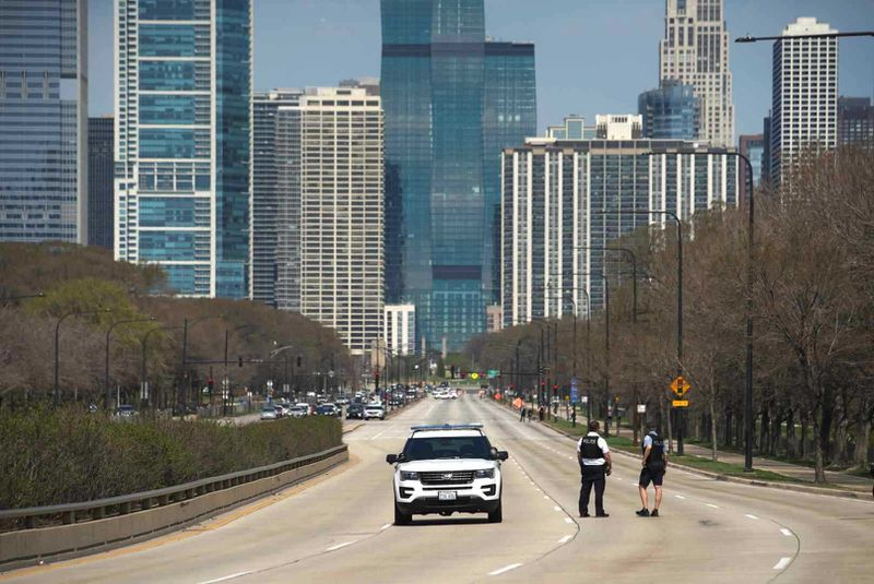 Police investigate after a child was shot April 6, 2021, near at Monroe and Lake Shore drives near Grant Park.