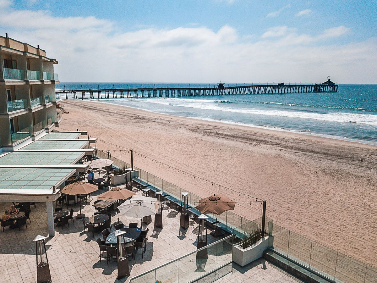 The outdoor patio overlooking the beach and the IB pier at SEA180.