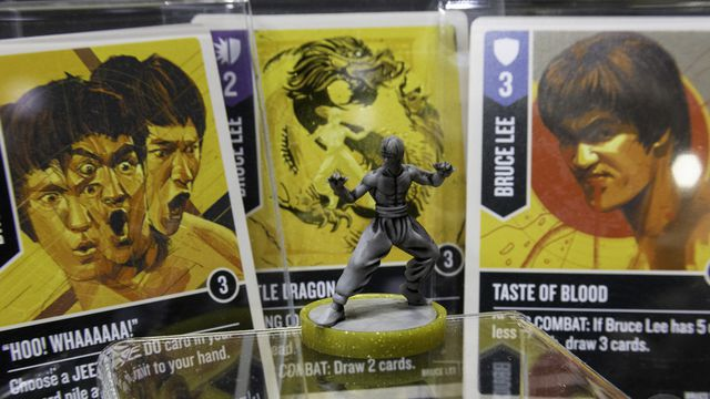 A Bruce Lee miniature, along with cards with art and design from Mondo, for Unmatched. The tactical miniatures game was revealed at Gen Con 2019.