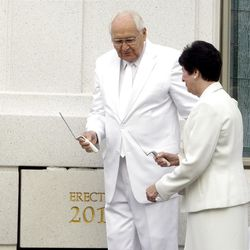 Elder L. Tom Perry steps to the side to allow his wife Sister Barbara Perry room to put mortar around the cornerstone. About 200 take part in the cornerstone ceremony at the Brigham City Temple prior to the dedication Sunday, Sept. 23, 2012.