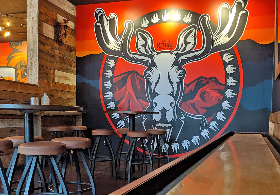 A mural of a moose on a tavern wall