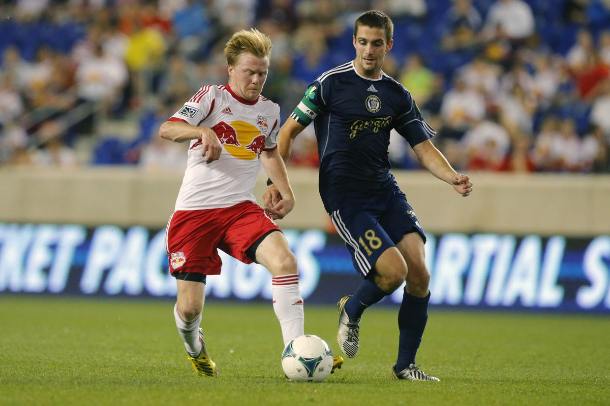 Neumann (right) in action away from college
