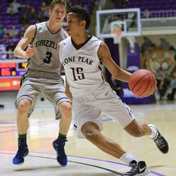 Lone Peak's Frank Jackson drives to the hoop with Copper Hills' Bailey Brooks defending Monday, Feb. 23, 2015, in the first round of the 5A boys basketball tournament at Weber State in Ogden. Lone Peak won 99-74.