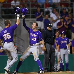 LSU Tigers infielder Jacoby Jones (23) is congratulated by catcher Ty Ross (26) after a home run in the eighth inning against the Oklahoma Sooners during   the Baton Rouge super regional of the 2013 NCAA baseball tournament.