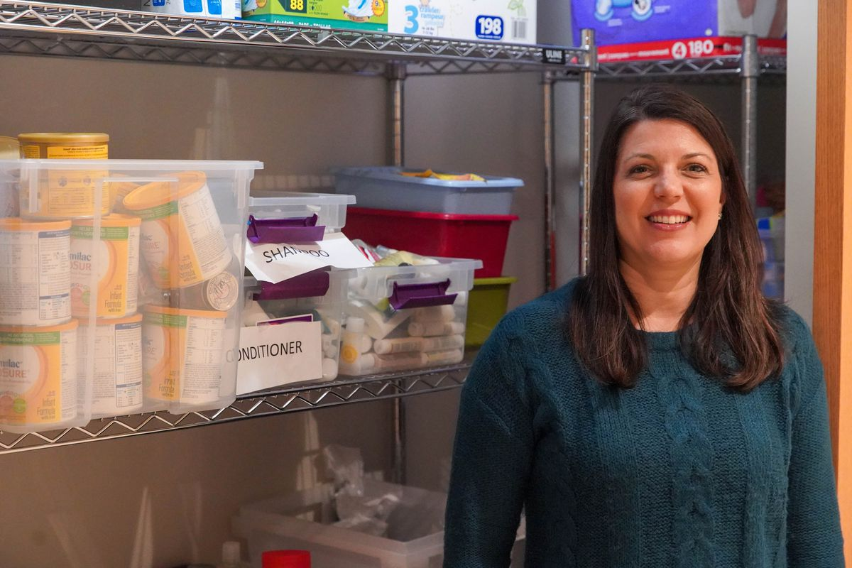 """Carol Gall, executive director of Sarah's Inn, at the domestic violence group's emergency pantry. The coronavirus shutdown presents an """"enormous challenge"""" for domestic abuse victims who are stuck at home with their abusers, Gall says."""
