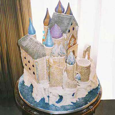 Colorful unique gingerbread house in the shape of a castle with 11 towers.