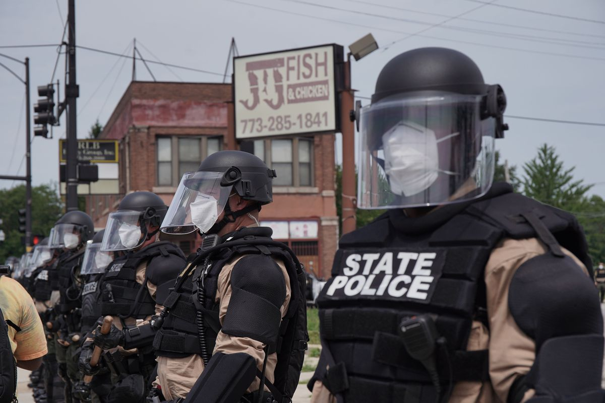Illinois State Police block protestors from the Dan Ryan Expressway Saturday on the South Side.