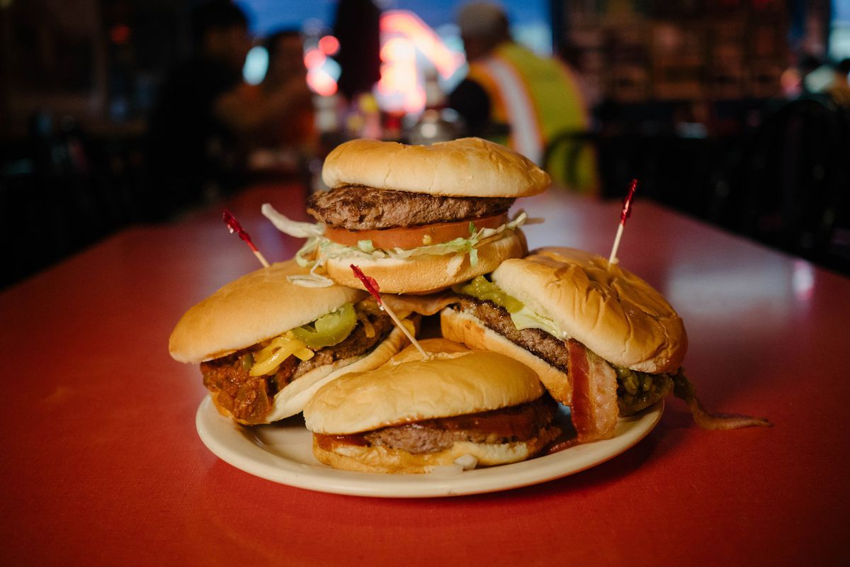 A pile of burgers from Hut's Hamburgers