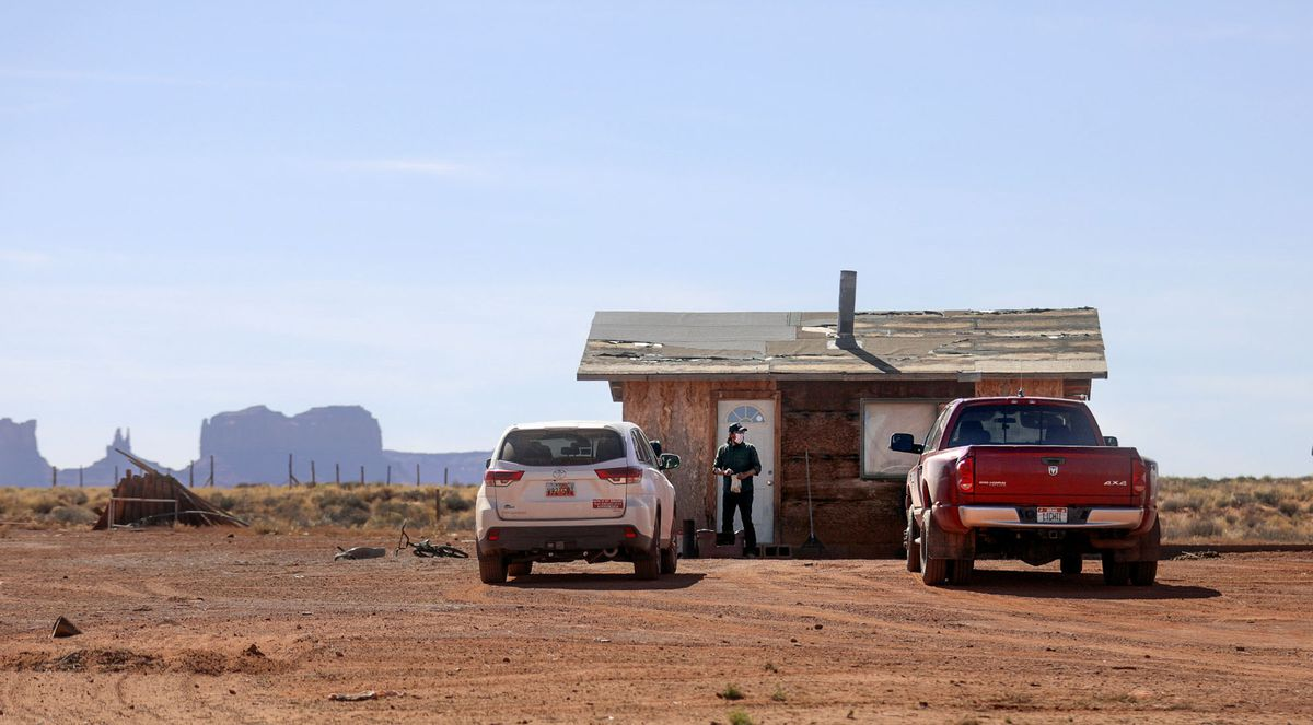 Pete Sands, Utah Navajo COVID-19 Reliefprogramproject manager, looks for an elder who isn't home as he delivers food near Monument Valley, San Juan County, on Wednesday, April 29, 2020. TheNavajo Nation has one of the highest per capita COVID-19 infection rates in the country. It's not unusual for Sands and his team to drive hours to a remote location and either struggle to find the elder's home due to lack of street addresses or find the home with nobody around to confirm if it's where they should leave the food. It's a time-consuming process, but one that Sands and his team are dedicated to.