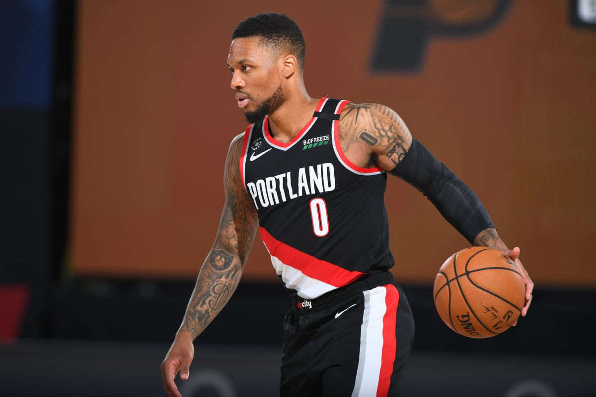 Damian Lillard of the Portland Trail Blazers handles the ball against the Indiana Pacers during a scrimmage on July 23, 2020 at HP Field House at ESPN Wide World of Sports in Orlando, Florida.