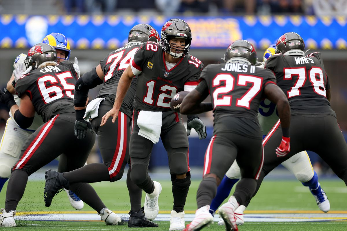 Tom Brady #12 of the Tampa Bay Buccaneers hands off to Ronald Jones #27 during a 34-24 loss to the Los Angeles Rams at SoFi Stadium on September 26, 2021 in Inglewood, California.