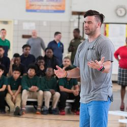 BYU quarterback Tanner Mangum addresses New York City youth during a clinic last weekend.