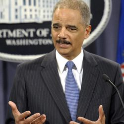 Attorney General Eric Holder takes part in a news conference at the Justice Department in Washington, Wednesday, April 11, 2012. The Justice Department and several states have sued Apple Inc. and major book publishers, alleging a conspiracy to raise the price of electronic books that Attorney General Eric Holder says cost consumers millions of dollars.
