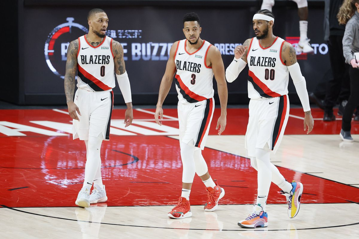 Portland Trail Blazers Damian Lillard, CJ McCollum and Carmelo Anthony walk back to the court after a timeout during the second half against the Dallas Mavericks at Moda Center.