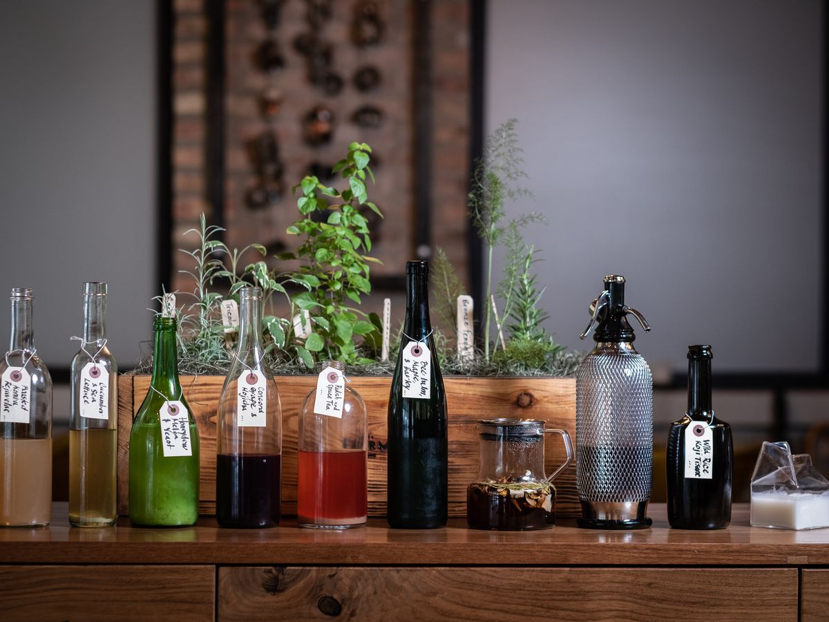 Bottles lined up on a wooden table.