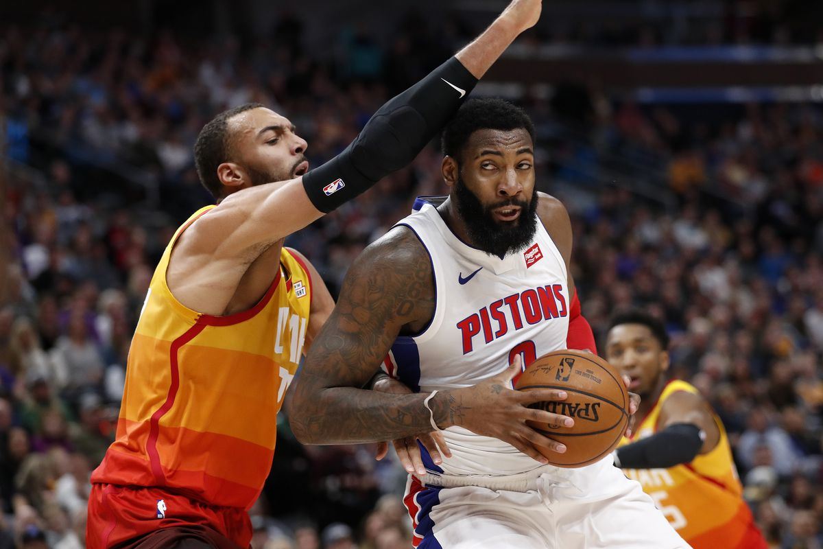 Detroit Pistons center Andre Drummond drives to the hoop against Utah Jazz center Rudy Gobert during the first quarter at Vivint Smart Home Arena.