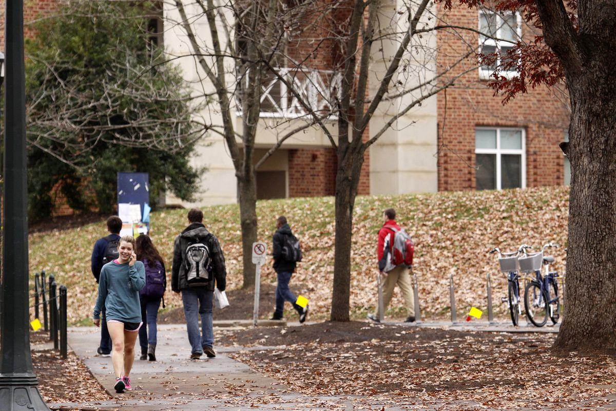 Students walk around the UVA campus.
