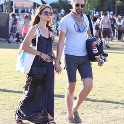 Nikki Reed ties a knot at the hem of her maxi dress to keep it from dragging.