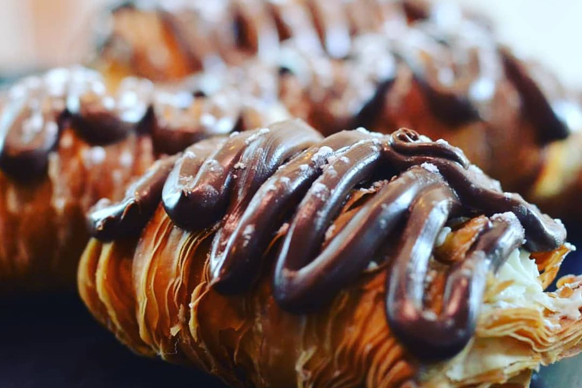 Lobster tails topped with chocolate.