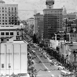 Christmas decorations on Salt Lake's Main Street in December 1948 featured a large Christmas tree and evergreen garlands strung across the street.