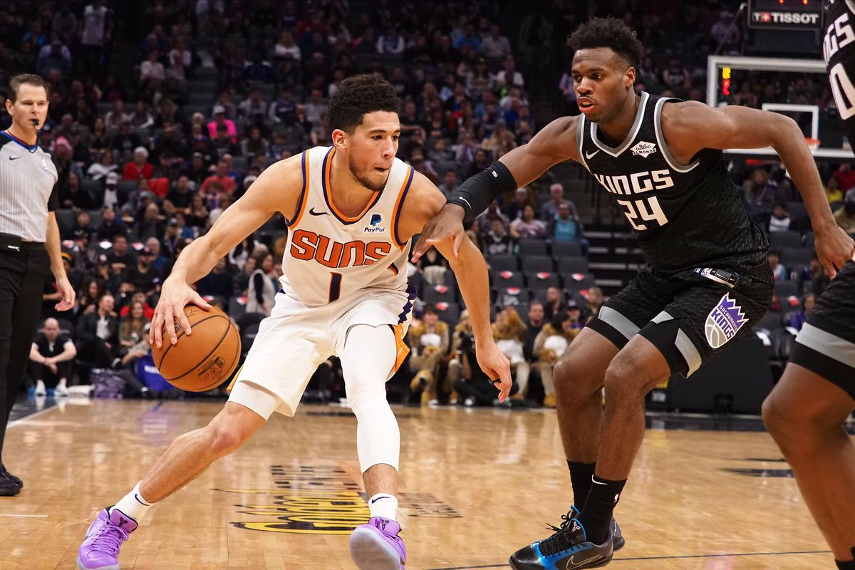 Phoenix Suns guard Devin Booker drives in against Sacramento Kings guard Buddy Hield during the third quarter at Golden 1 Center.