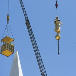The lightning-damaged statue of the Angel Moroni on the Bountiful Utah Temple is removed on Wednesday, June 1, 2016, in Bountiful. Lightning struck the statue on May 22, 2016.