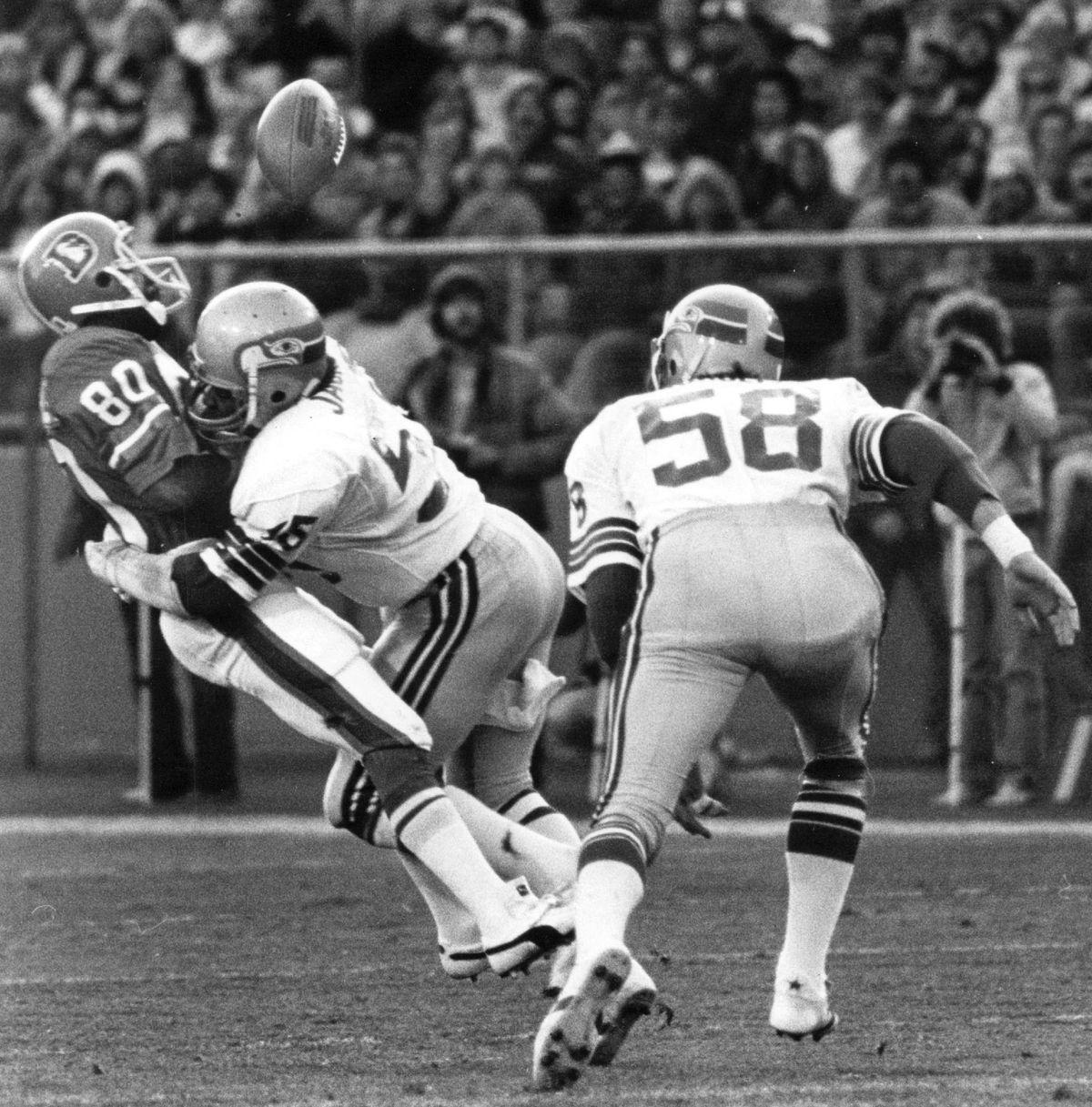 NOV 21 1982, NOV 22 1982; Football - Denver Broncos (Action); Broncos' Rick Upchurch takes a hard hi