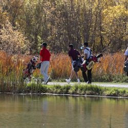 Golfers walk around a point during the 3A boys state golf championship at Round Valley Golf Course in Morgan on Thursday, Oct. 8, 2020.
