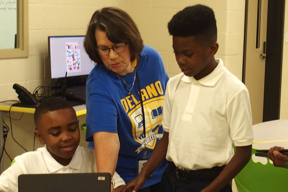 Delano Optional Elementary students learn how to use laptops that fold into tablets while playing a get-to-know-you Bingo game on the first day of school.