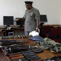 Kenya Police spokesman View Eric Kimathi displays seized arms and  ammunition to journalists in Nairobi, Kenya, Friday, Sep. 14, 2012. Kenyan police say they have arrested two people suspected to have links with an al-Qaida-linked Somali militant group that was in the last stages of planning a major terrorist attack. Boniface Mwaniki , the head of Kenya's Anti-Terrorism Police Unit, said Friday that police found four suicide vests, a cache of weapons and 12 grenades. Al-Shabab has vowed to carry out terror attacks in Kenya in retaliation against the country for sending troops into Somalia. (AP Photo/Khalil Senosi)