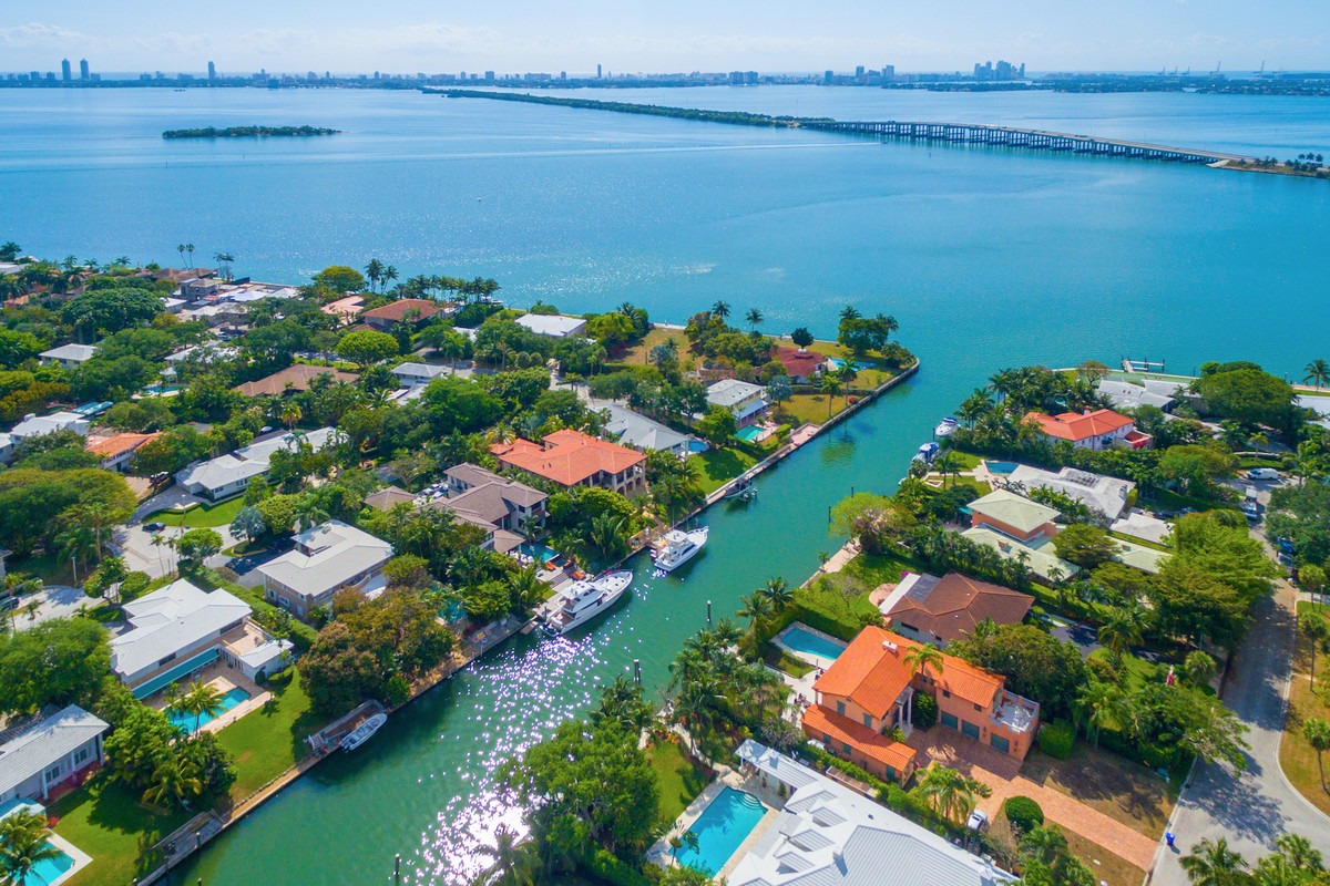 Aerial of homes on the water in a fancy Miami community on the bay.