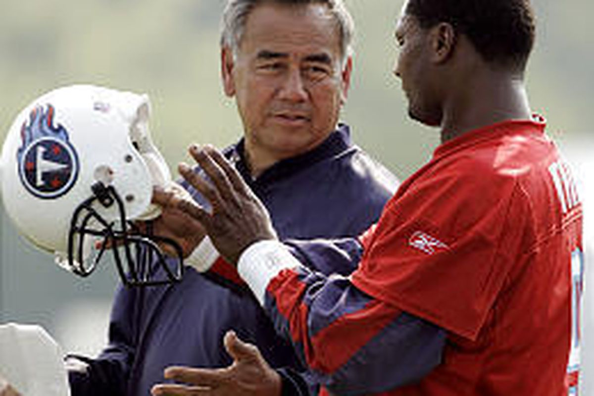 Tennessee Titans offensive coordinator Norm Chow, left, talks with quarterback Steve McNair. Chow is one of 12 new NFL offensive coordinators this season.