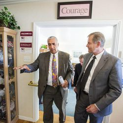 Salt Lake County District Attorney Sim Gill, left, talks with the LDS Church Presiding Bishop Gary E. Stevenson as LDS leaders tour the Avenues Children's Justice Center Tuesday, April 28, 2015, in Salt Lake City.