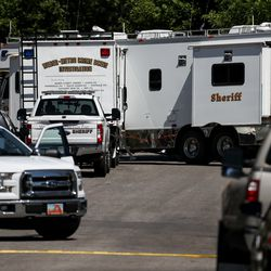 A heavy police presence is seen at the scene of an officer-involved shooting on Jackson Avenue in Ogden on Thursday, May 28, 2020.Police said one officer and a suspect were killed, while another officer was injured, in an exchange of gunfire earlier in the day.