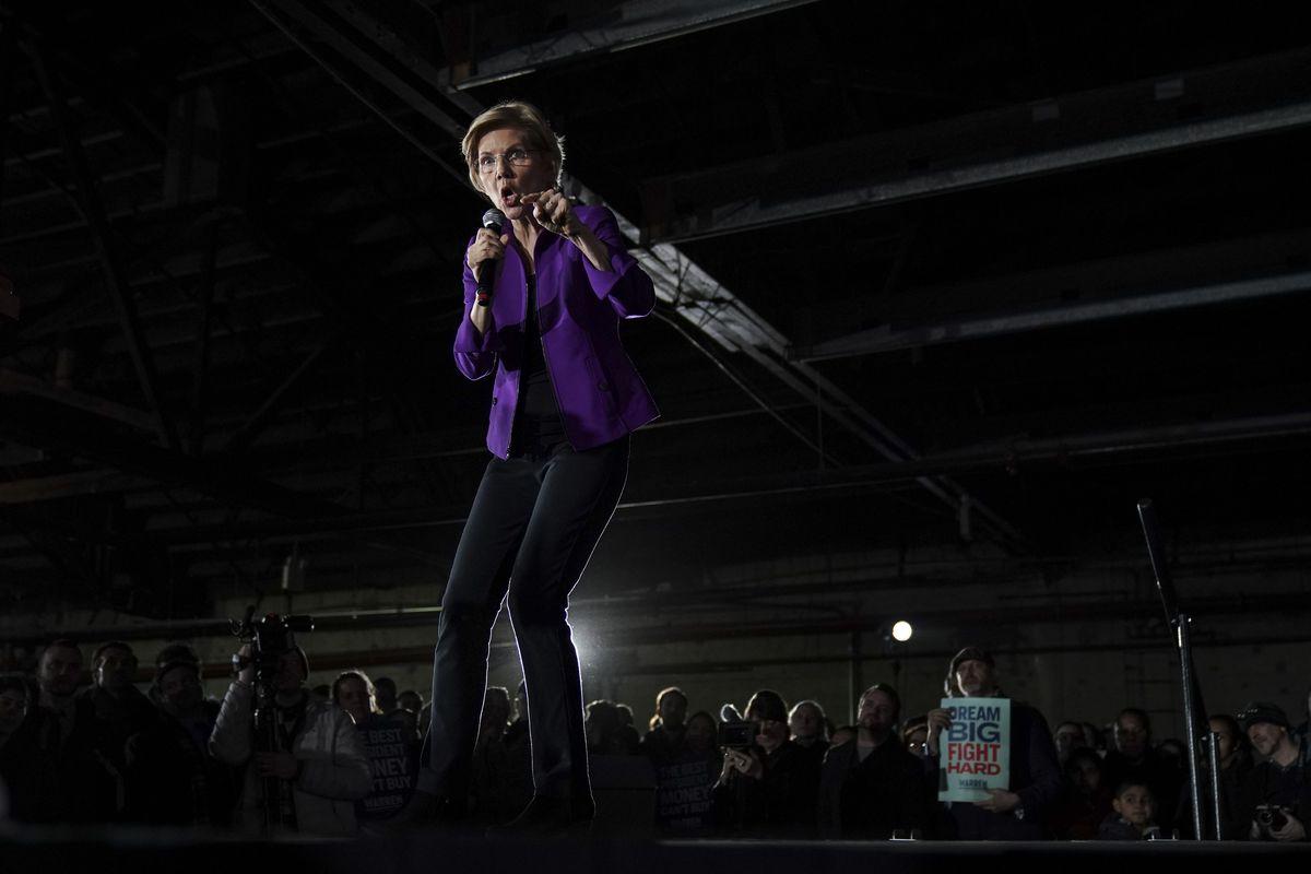 Senator Elizabeth Warren speaking onstage.