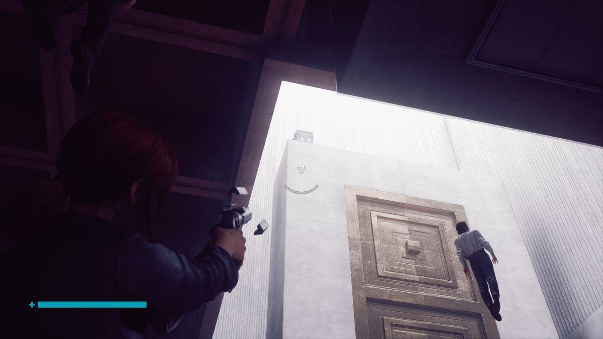 A woman aims a gun at a white pillar