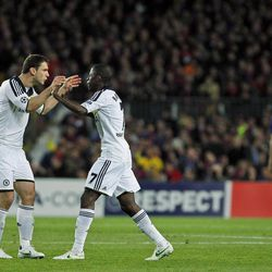 Chelsea's Ramires from Brazil, second left, celebrates his goal with Branislav Ivanovic from Serbia, left, during a Champions League second leg semifinal soccer match against Barcelona at Camp Nou stadium, in Barcelona, Spain, Tuesday, April 24, 2012. Chelsea drew 2-2 with Barcelona to win the match 3-2 on aggregate.