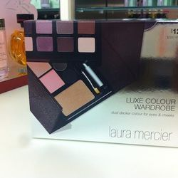 """Here's the Laura Mercier Luxe Colour Wardrobe, $125. The ladies refer to this as the """"ultimate makeup traveler, in a sleek case."""" It includes a compact and easy-to-pack range of eyeshadow, blush, eyeliner, bronzer, and more."""