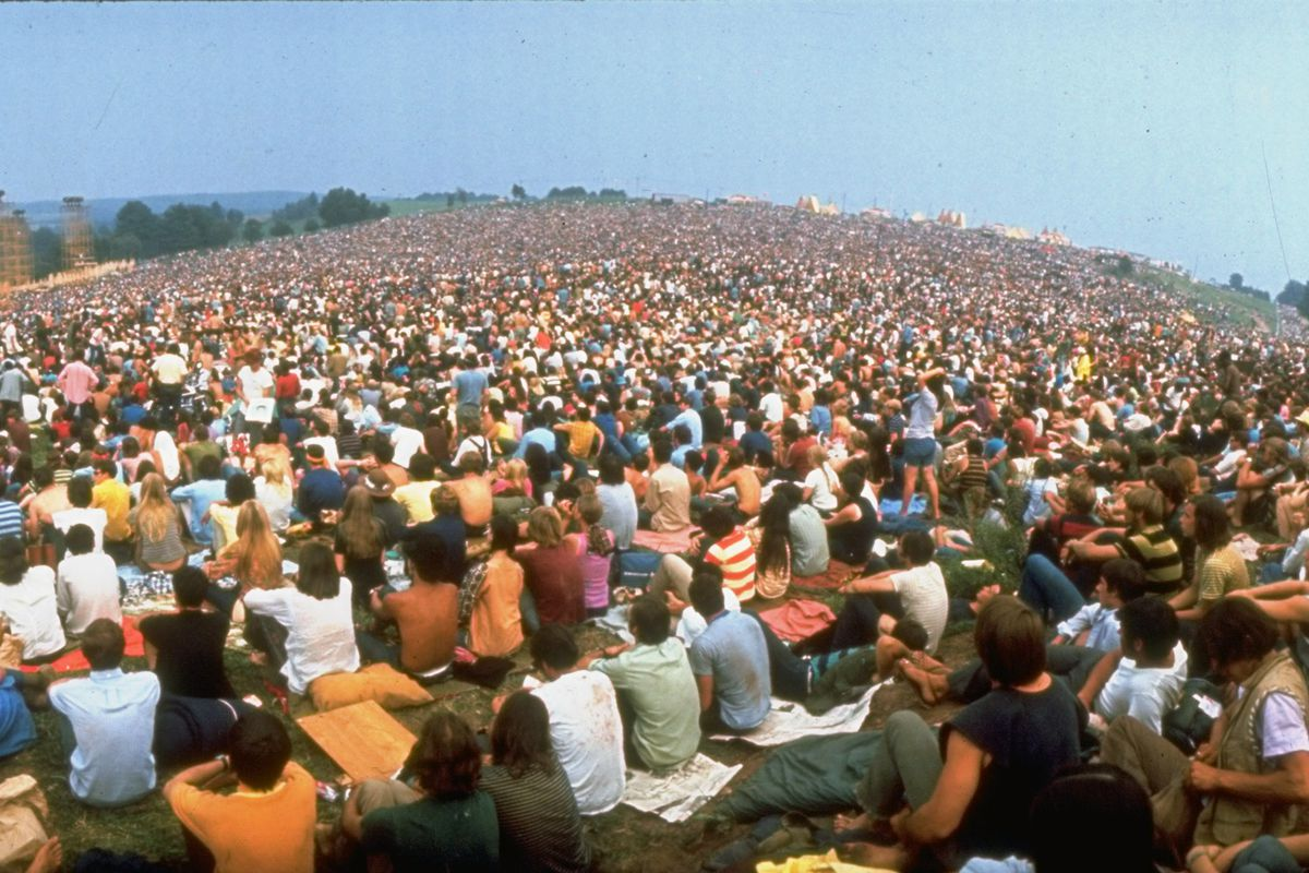 Wide-angle pic of seated crowd listening