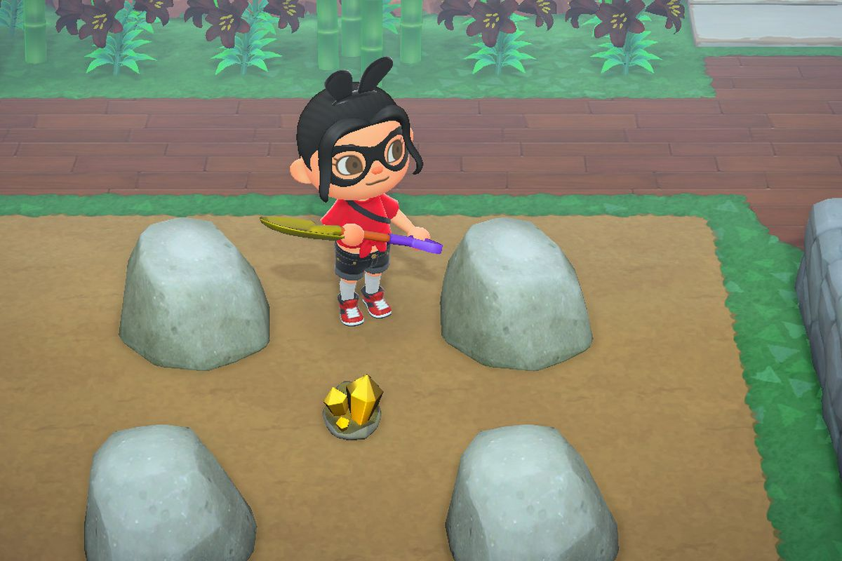 An Animal Crossing character stands in a rock quarry with a single Gold Nugget on the floor