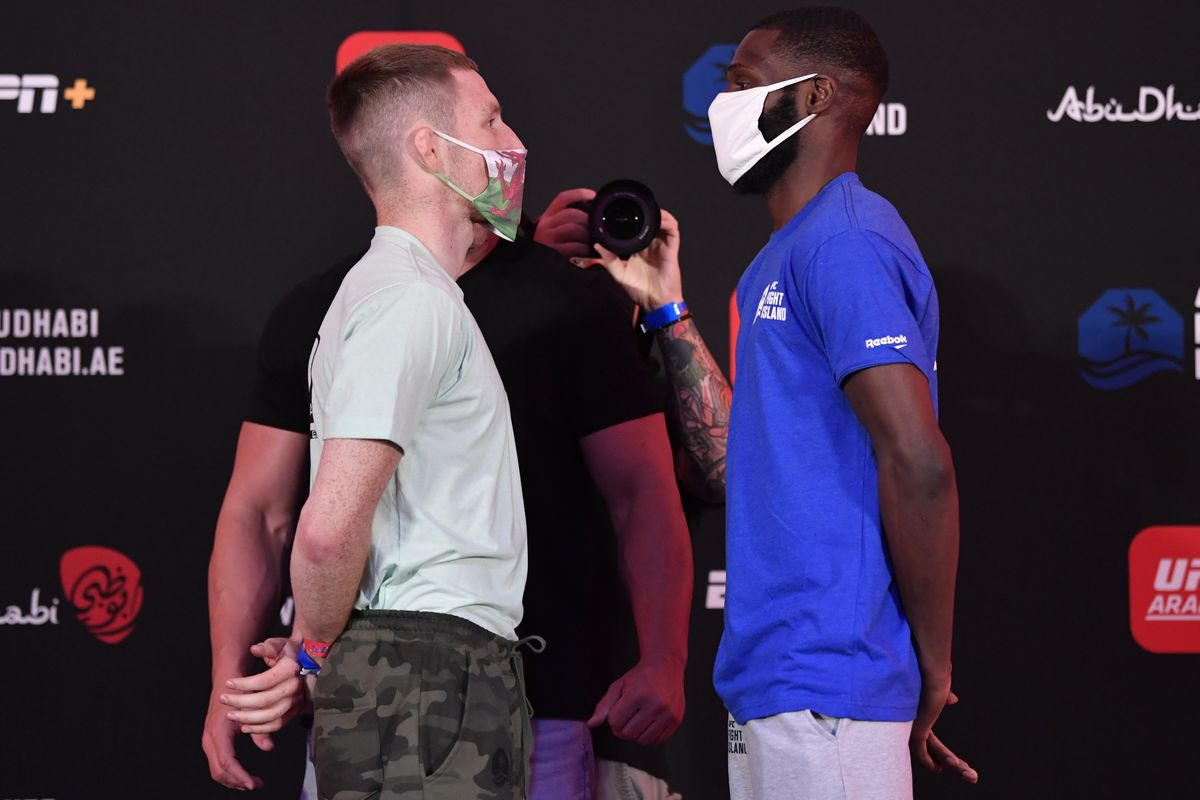 Opponents Brett Johns of Wales and Montel Jackson face off during the UFC Fight Night weigh-in inside Flash Forum on UFC Fight Island on July 17, 2020 in Yas Island, Abu Dhabi, United Arab Emirates.