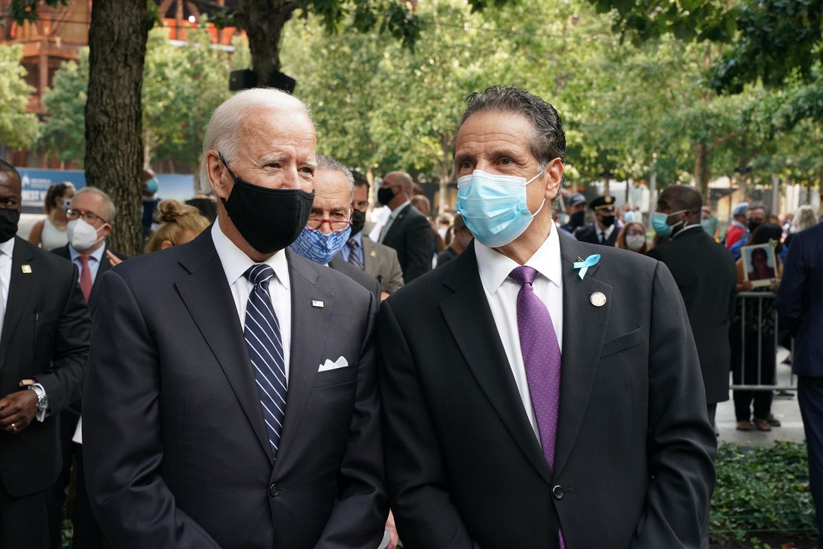 Gov. Andrew Cuomo speaks with former Vice President Joe Biden during a ceremony commemorating 9/11 victims.