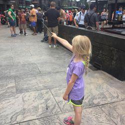 Erin Stewart's daughter casts spells at Harry Potter World.